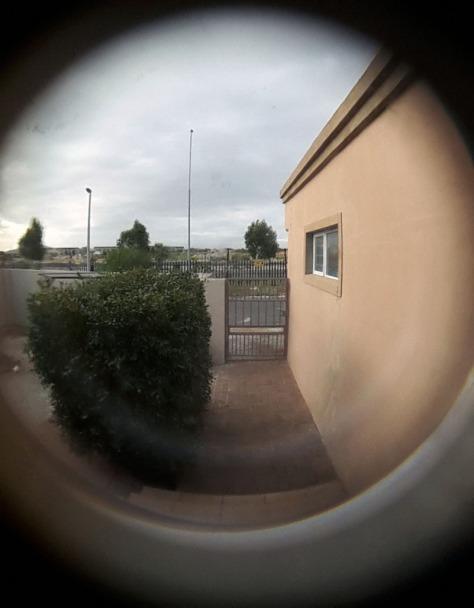 Peep home in door