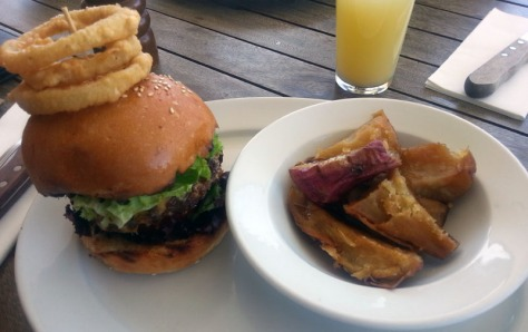 Burger and sweet potato at Woodstock Grill & Tap.