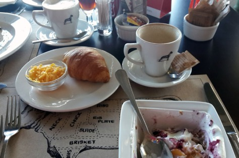 Muesli, fruit and croissant and cappuccino at The Local Grill.