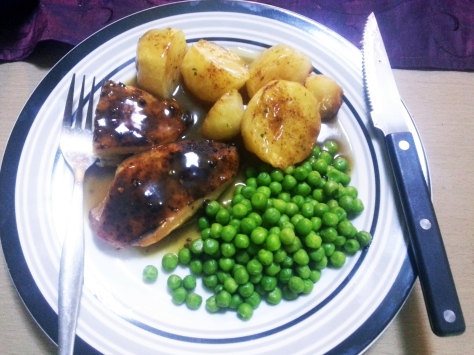 Homemade roast chicken, peas and roast potatoes