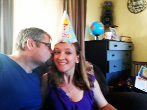 Birthday hat kiss on cheek