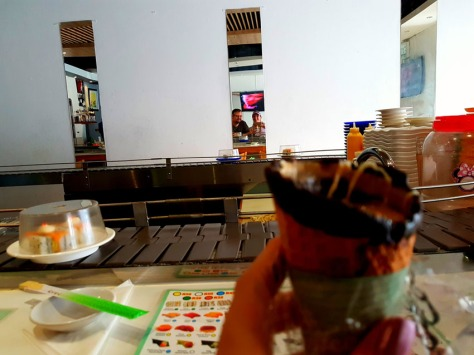 Sushi at The Orient and coffee in a cone