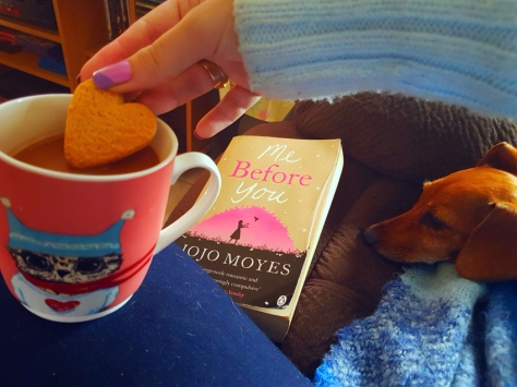 Reading with coffee and dog