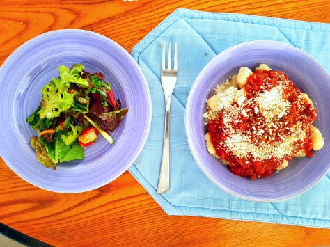 Gnocchi and salad.