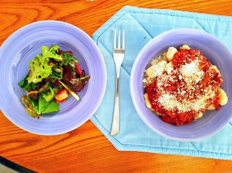 Gnocchi and salad.