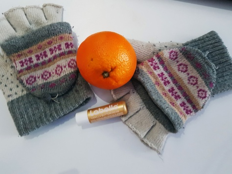 Fingerless gloves and oranges