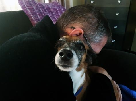 Dog hug on couch