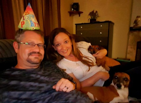 Birthday hat photo with dogs