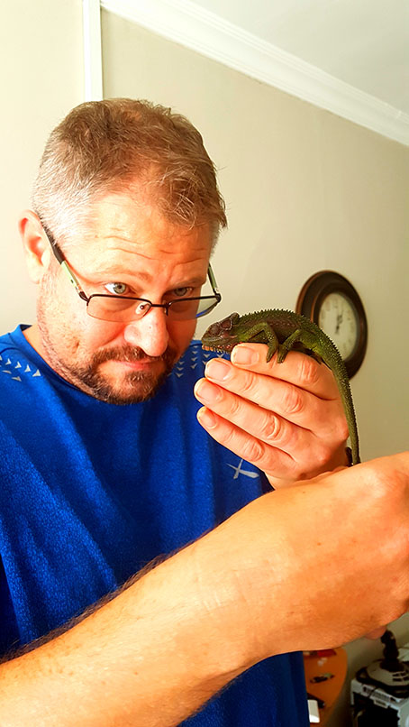 Husband made friends with a chameleon that had been exploring the garden. Much larger than the little guy from a few weeks ago. Click here if you've forgotten!