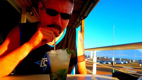 Husband, busy with his Ol' Spice mojito, featuring spiced rum, lime, mint, ginger, pineapple and soda.