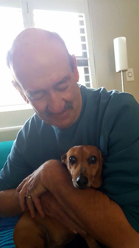 Sweet Bassie having cuddles with her Grampa later that afternoon.