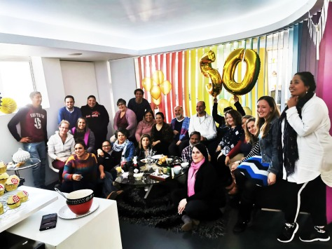 Happy birthday! See Andre in white, just to the left of the gold '50' balloons, with the rest of team Biz gathered around.