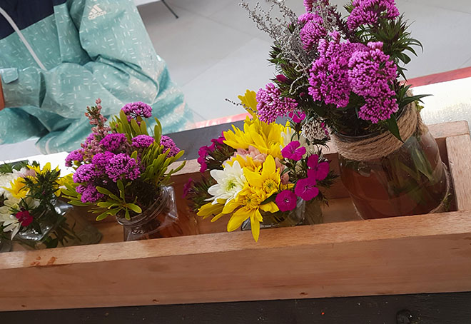 Bright bunches of wild flowers on display in the eating area of the Willowbridge market.