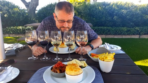 Husband looking pleased with the lay of the land at our Eat @ Perdeberg table.